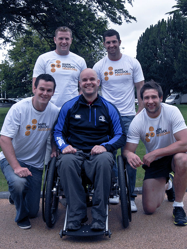 Mark Pollock with rugby players